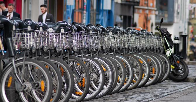 A row of bikes for rent on a Dublin street