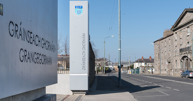 A view down a street in Dublin with the entrance to DIT Grangegorman on the left