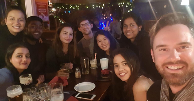 A group of students sitting in a bar