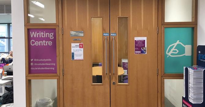 """Closed wooden doors and a sign that reads """"Writing Centre"""""""