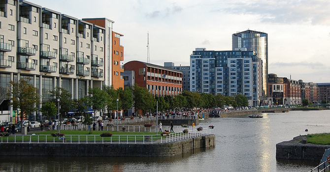 A view along the quay in Limerick City showing the water, and buildings surround it