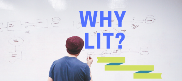 Man in a hat and blue tshirt writing on a white board