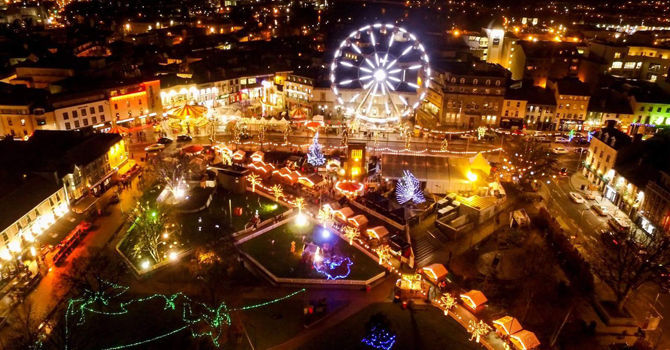The city of Galway at night, taken from above, lit up with lights