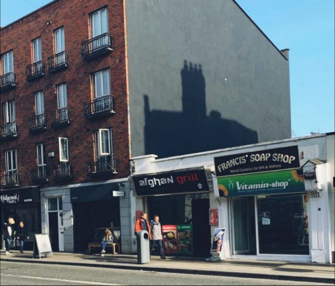 Row of shops on a Dublin street. sign on front of shop reads Afghan grill
