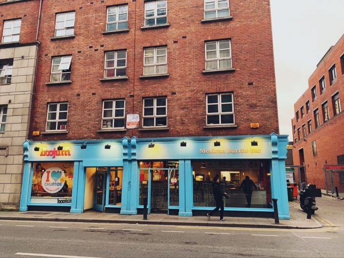 Red bricked building on Dublin street, blue sign that reads Boojum