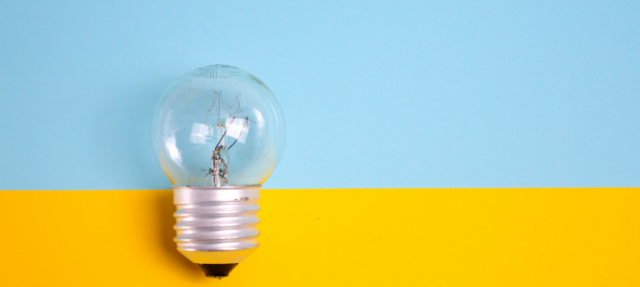 lightbulb against a blue and yellow background