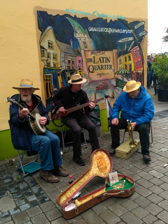 street performers with traditional Irish instruments