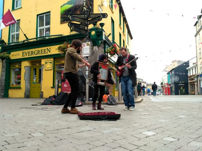 Street performers dancing and playing instruments
