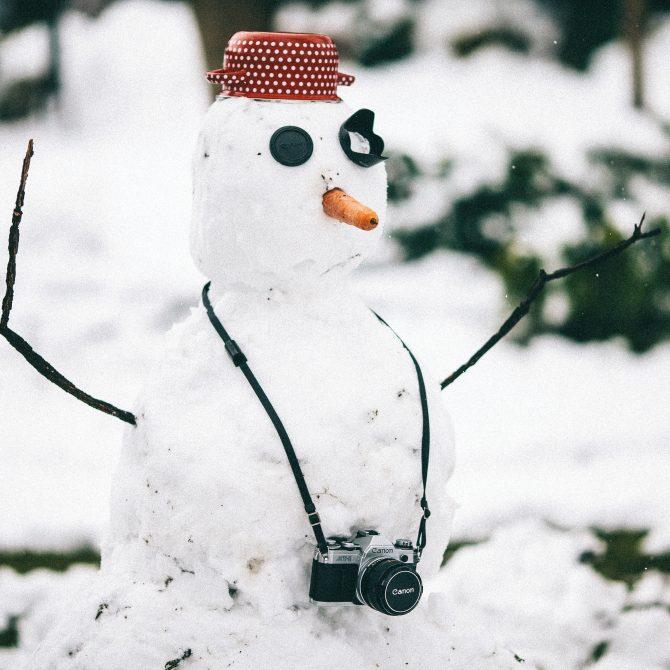 snowman wearing a camera