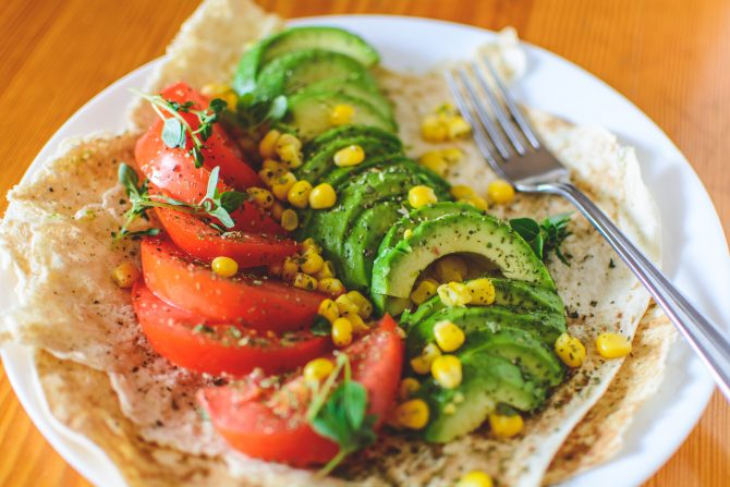 Avocado, tomato and sweetcorn kernels on a plate