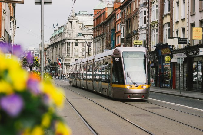 Luas tram travelling past shop fronts