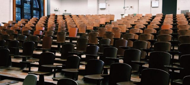 tiered wooden seating in a lecture hall