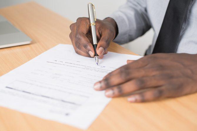 Man signing signature
