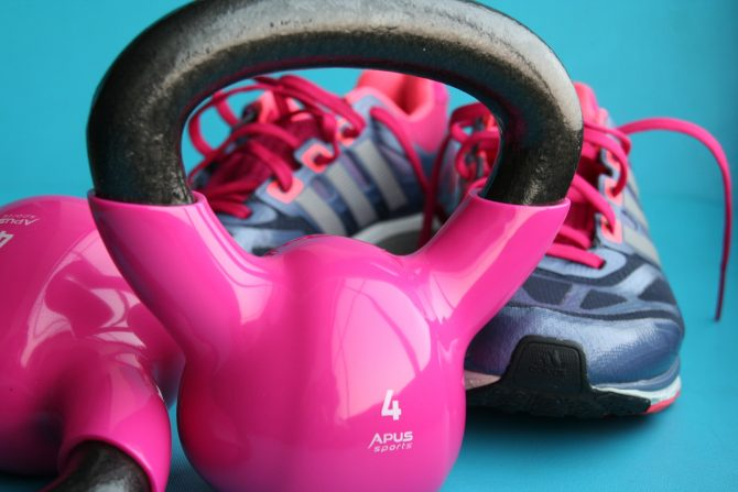 Pink kettle bell and blue and pink running shoes