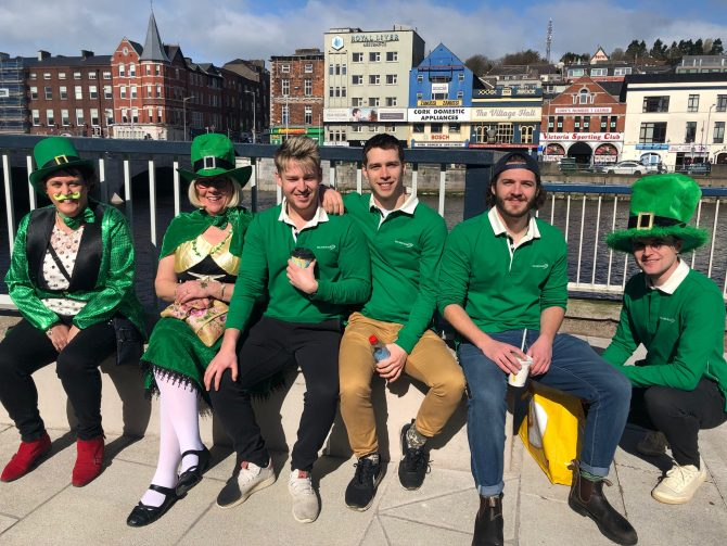 Group of six peopole in matching green shirts
