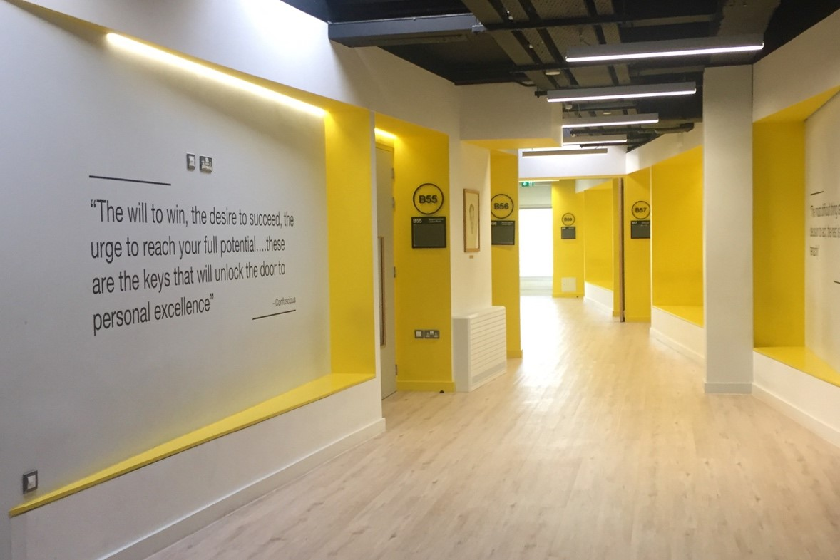 Brightly lit corridor with yellow walls