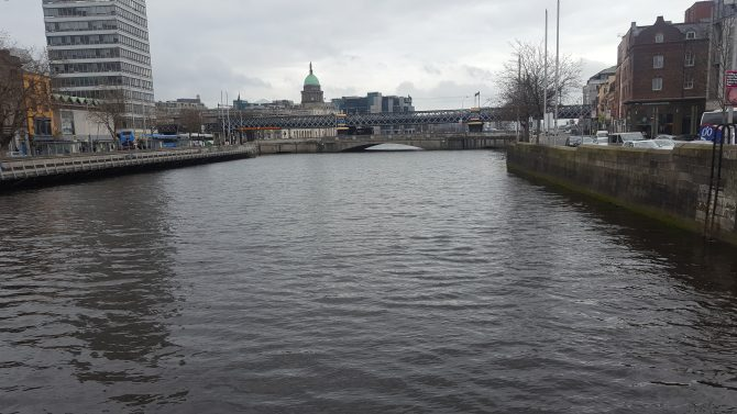 River Liffey at high tide with custom house quay in the background