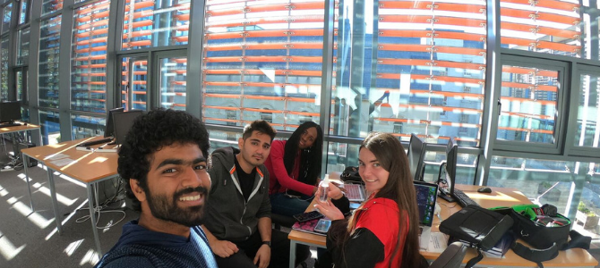 group of students smiling in a study session